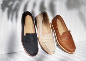 loafers-leaning-along-white-wall