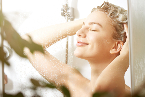 Beautiful,Satisfied,European,Woman,Washes,Away,Shampoo,From,The,Head