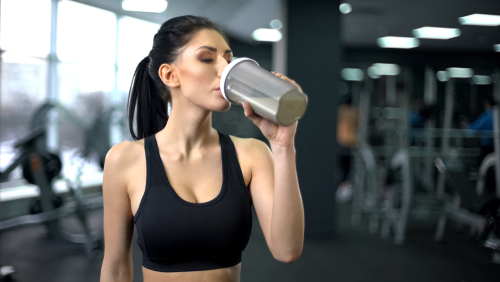 Sporty,Woman,Drinking,Protein,Shake,After,Workout,,Muscle,Gain,Nutrition,
